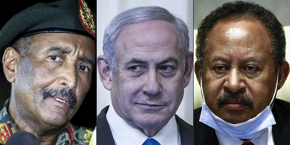 PHOTO/ ASHRAF SHAZLY/SARAH SILBIGER/AFP: The President of the Transitional Council of Sudan, Abdel Fattah al-Burhan, Israeli Prime Minister Benjamin Netanyahu and the Prime Minister of Sudan, Abdullah Hamduk.