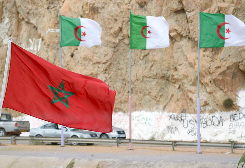Moroccan and Algerian flags in Saidia, on the border between the two countries