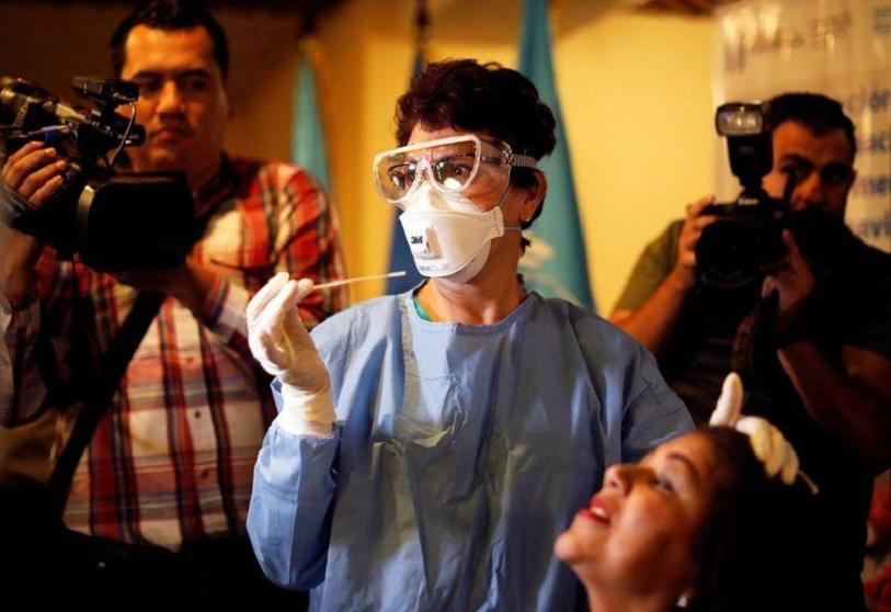 Stock photo. Guatemalan health worker participates in a drill to treat suspected cases of coronavirus, in a hotel in Guatemala City, Guatemala, February 26, 2020
