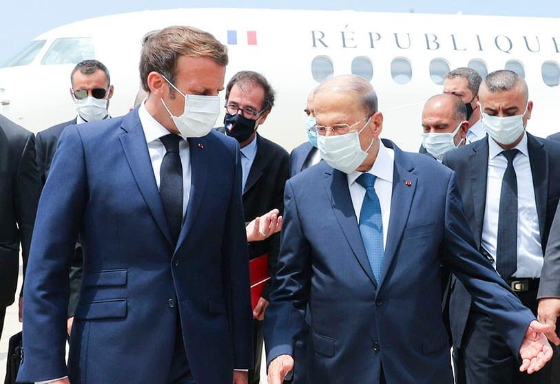 Lebanon's President Michel Aoun welcomes French President Emmanuel Macron on his arrival at Beirut International Airport for a visit to express his solidarity with Lebanon after a massive explosion left the city destroyed