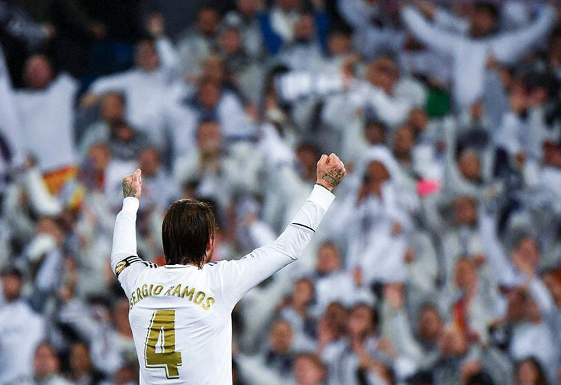 Real Madrid's Spanish defender Sergio Ramos celebrates with fans during the Spanish League football match between Real Madrid and Barcelona at Madrid's Santiago Bernabéu stadium on 1 March 2020