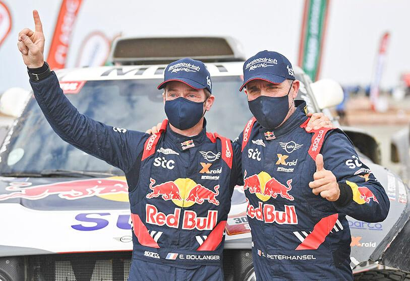 French driver Stéphane Peterhansel (right) celebrates with a teammate after his victory in the Dakar Rally in Saudi Arabia on 15 January 2021