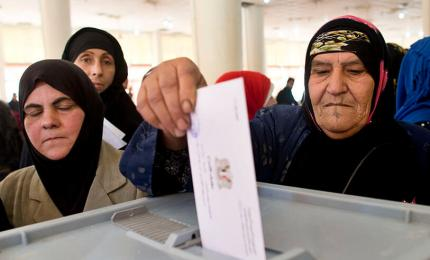 A Syrian woman votes at an electoral college during the Syrian parliamentary elections in Damascus, Syria, on 13 April 2016