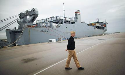 A U.S. Army soldier passes in front of the MV Cape Ray, docked at Rota Naval Air Base (Cadiz)