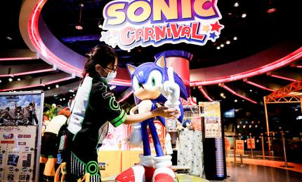 "A woman cleans the character of the video game ""Sonic the Hedgehog"" after the reopening of the Joypolis Park located in Japan where the coronavir"