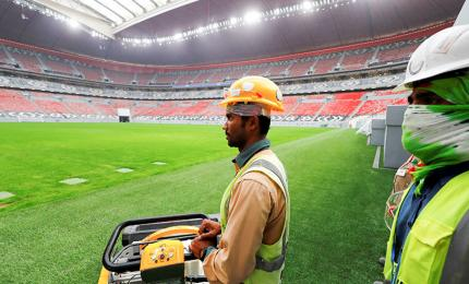 Workers at Al Bayt Stadium, built for the upcoming FIFA World Cup football championship in 2022, during a tour of Al Khor Stadium, north of Doha, Qatar